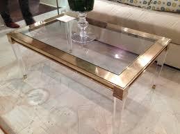 salma acrylic and brass coffee table mecox gardens