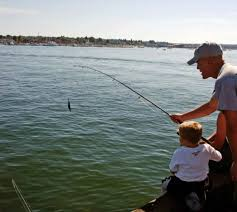 File:Father and son fishing little boy helps his father to fish