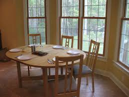 kitchen round wooden dining table wooden dining chairs with linen