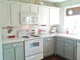 i like this with the white tops white backsplash and the grey kitchen cabinet colors with white appliances remodelaholic painting oak cabinets white and gray