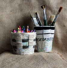 that artist woman basket weaving using recycled containers