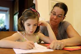 Stacey Jacobson Francis works on math homework with her   year old daughter Luci Wednesday