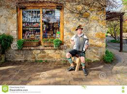 man playing accordion near german village shop in hahndorf