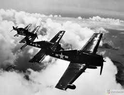 high angle view of four fighter planes flying in formation f6f high angle view of four fighter planes flying in formation f6f hellcat