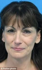 Suspect: Michele Marie Williams called 911 before dawn on October 13, 2011, and told operators that an intruder killed her husband - article-2086350-0F733F3F00000578-152_233x389