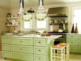 traditional kitchen with green cabinet colors and walls with white