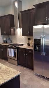 white oak wood ginger yardley door dark brown cabinets kitchen