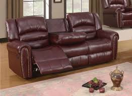 burgundy leather reclining sofa with console and nailhead trim