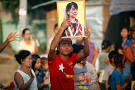 Aung San Suu Kyi will take part in 'decisive' Myanmar vote despite ...