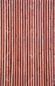 the wooden vertical background from low grade wooden slats stock