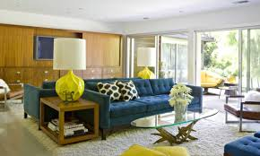 mid century modern living room ideas with blue sofa and round