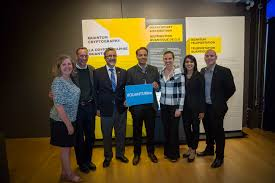 Special guests at the launch of QUANTUM  The Exhibition holding a sign with the hashtag