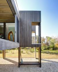 House On Pilings by Stunning Floodplain Home Incorporates Unique And Functional Pilings