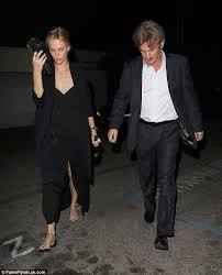 Charlize Theron in low cut dress with rumoured fiance Sean Penn