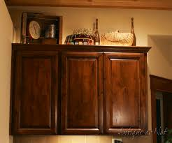 Kitchen Cabinet Top Decor by Antique Or Not Decorating Above Your Cabinets