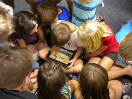 children viewing iPad