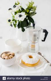 elegant white breakfast table setting with flowers coffee cup and