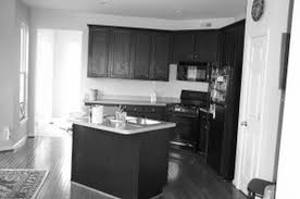 u shaped black glossy wooden kitchen cabinets on ceramics flooring