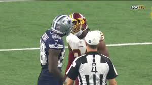 thanksgiving day cowboys game dez bryant and josh norman come helmet to helmet during game nfl