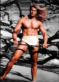 Fabio in loincloth holding a stick