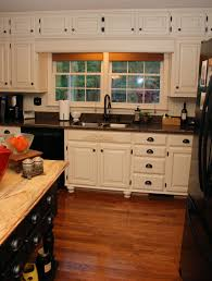 White Kitchen Cabinets With Black Granite Countertops by From Oak Kitchen Cabinets To Painted White Cabinets Oak Kitchen