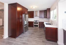 cherry cabinets in kitchen gray wood floors warm cherry cabinets white counters