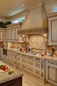 best 25 luxury kitchens ideas on pinterest luxury kitchen 20 x 15 x 10 high l shaped kitchen cabinetry with glaze and antiquing mahogany island has carved elements with paneling drawers and doors