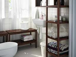 smart bathroom with recessed shelves beside rectangular mirrors