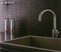 classy black modern kitchen tile backsplash with rectangular tiles