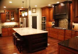 walnut island with granite top dark wooden kitchen cabinet