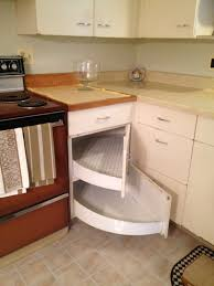 pull down shelves in an overhead cabinet are capable of holding
