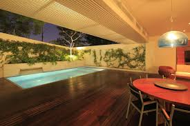 In Door Pool by Modern Residential House Idea With Semi Indoor Lap Pool And Wooden