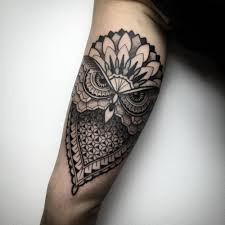 geometric blackwork style owl tattoo on the left inner arm tattoo