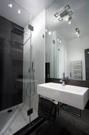 apartment minimalist bathroom design with glass door plus big minimalist bathroom design with glass door plus big mirror and classic white washbasin with towel holder
