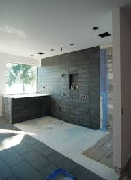 mastering the curbless shower custom home magazine design 2x8s to be well suited under the shower floor in general note that each situation has its own load factors and needs to be engineered independently