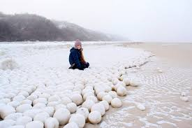 thousands of giant 3ft snowballs appear on russian beach