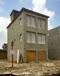 the new concrete block homes on a fifth ward block by the tracks