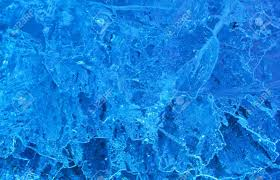 texture of ice with blue back light abstract background stock