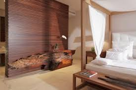 warm coastal house design including wooden bed with white cushion