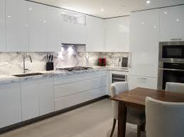 custom kitchen design white high gloss handle less cabinetry