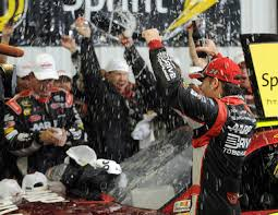 ... celebrates his victory in the Pennsylvania 400 at Pocono Raceway in Long Pond, Pa., Sunday, Aug. 5, 2012. Race was shortened due to rain. By Bill Huneke - 11395939-large