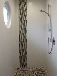 the vertical mosaic glass tile combined with the vertical white