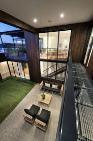 L Shaped Towhnome Courtyards 8 Airy Homes With Giant Glass Walls That Open To Courtyards