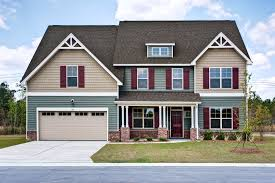 grayson c exterior craftsman style home green and tan siding
