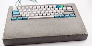 a diy concrete keyboard doubles as one heck of a paperweight