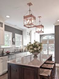 gray kitchen island with gold pendants ellajanegoeppinger com