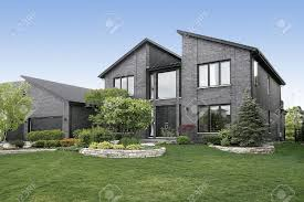 Home Modern Modern Home With Gray Brick And Black Door Stock Photo Picture