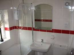 best bathroom floor tile ideas designs image of custom ceramic tile border application for ideas large size bahtroom simple window plus fresh flower decor above bathtub bit fancy bathroom
