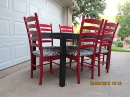 black dining table with red ladder back chairs lightly distressed