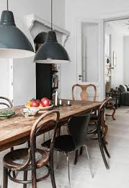 Rustic Modern Dining Room Tables by Mismatched Chairs Around A Rustic Modern Table With Industrial